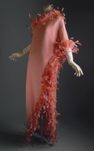 Salmon-colored silk evening gown with feathers 1968