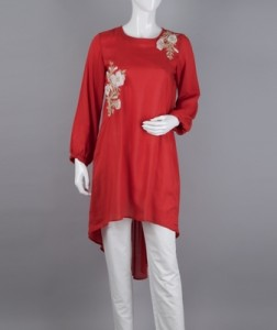Twists, knots and chiffon embroidered detailing. Simple techniques, elegantly executed, along with elasticated sleeves and box pleats at the back completes the look of this red clayed top.