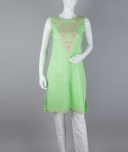 This cotton top in a shade of parrot green is embellished with beige cotton embroidery. Ruching on the armholes and hemline complete the look.