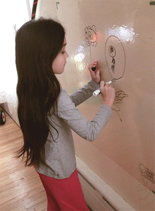 Girl-writing-on-wall-(1)